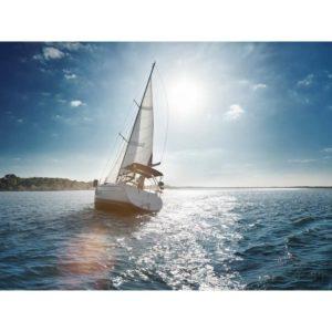 Boat Sailing Through A Still Sea Off The Coast Of An Island